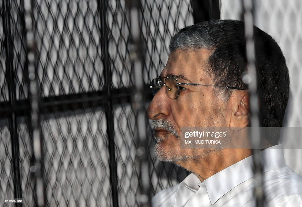 Former Libyan foreign intelligence chief Bouzid Dorda sits behind bars during a hearing in his trial on March 26, 2013. The former foreign intelligence chief, the first of Moamer Kadhafi's top officials to face justice, is accused of ordering security forces to use live ammunition against demonstrators last year.
