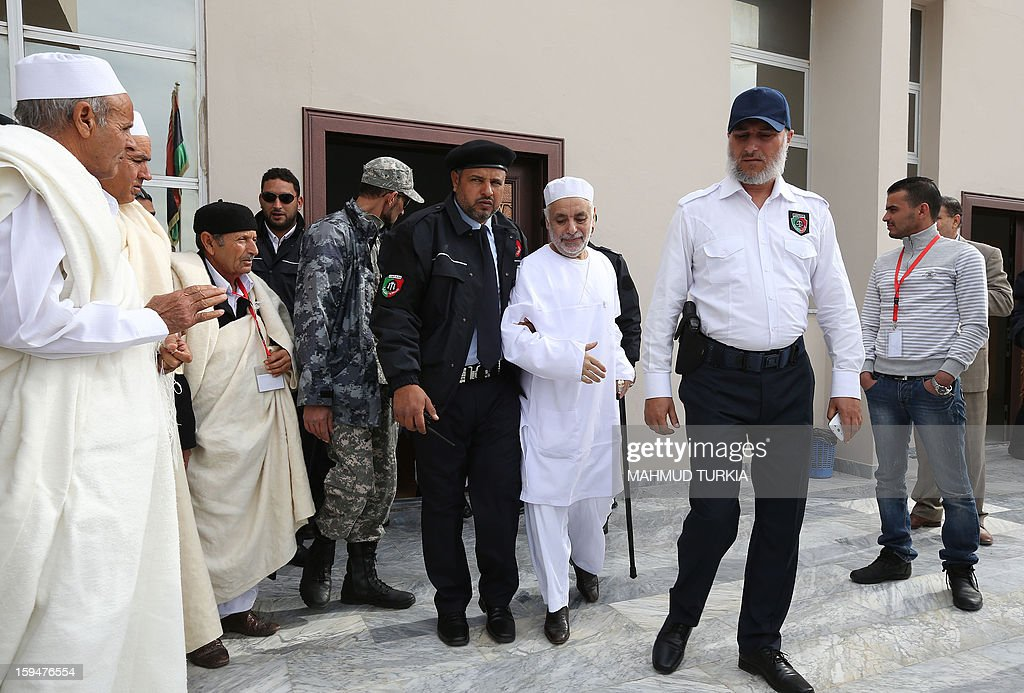 Former Libyan prime minister Baghdadi al-Mahmudi (C) is escorted by police to the court house in Tripoli for his trial, on January 14, 2013. The trial of Mahmudi, late Libyan dictator Moamer Kadhafi's last prime minister, continues in the Libyan capital as he faces charges of 'prejudicial acts against the security of state'.