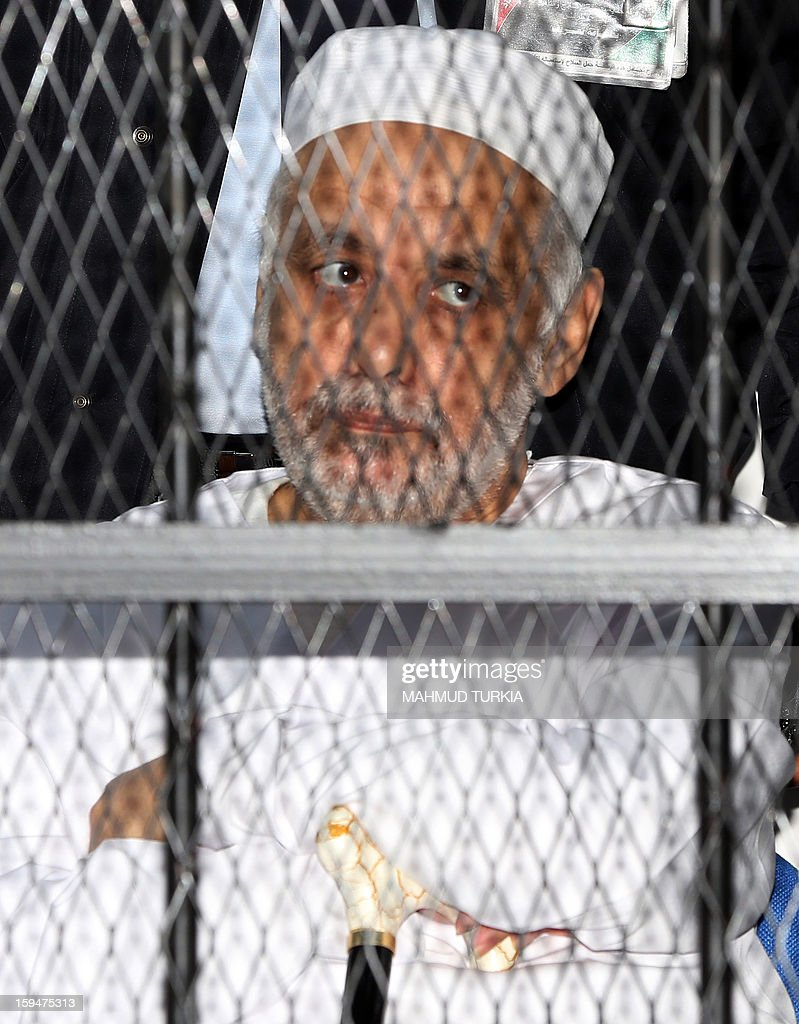 Former Libyan prime minister Baghdadi al-Mahmudi listens on as he sits behind bars in a courtroom in Tripoli, on January 14, 2013. The trial of Mahmudi, late Libyan dictator Moamer Kadhafi's last prime minister, continues in the Libyan capital as he faces charges of 'prejudicial acts against the security of state'.