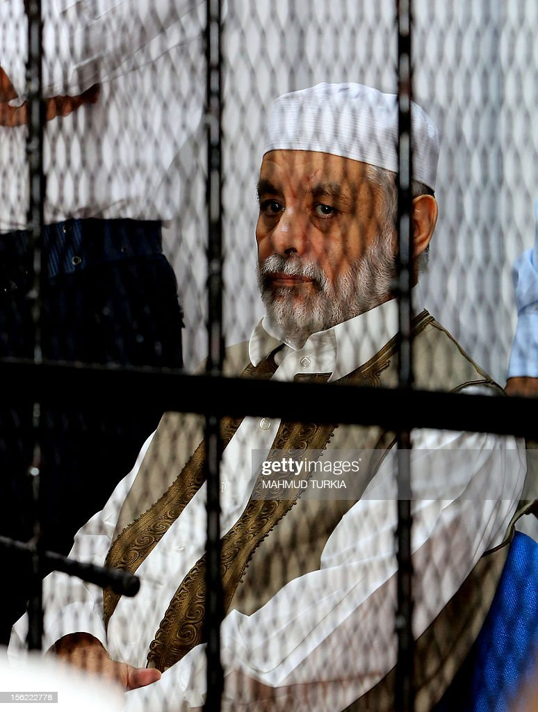 Former Libyan prime minister Baghdadi al-Mahmudi sits behind bars during the first hearing in his trial at a courtroom in Tripoli on November 12, 2012. The trial of Mahmudi, late Libyan dictator Moamer Kadhafi's last prime minister, opened in the Libyan capital as he faces charges of 'prejudicial acts against the security of state'. AFP PHOTO/MAHMUD TURKIA
