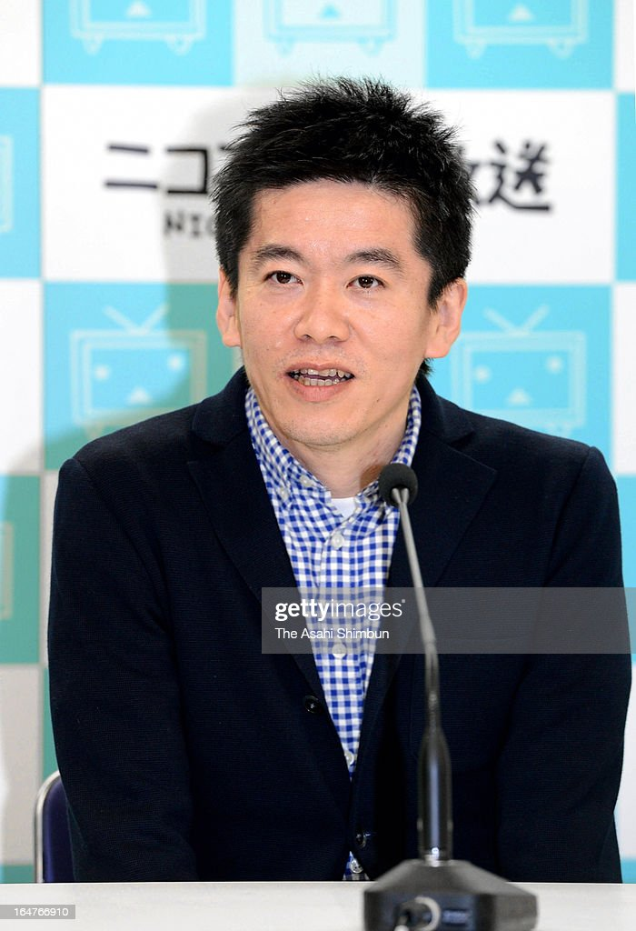 Former Livedoor president <a gi-track='captionPersonalityLinkClicked' href=/galleries/search?phrase=Takafumi+Horie&family=editorial&specificpeople=235770 ng-click='$event.stopPropagation()'>Takafumi Horie</a> speaks during a press conference after being paroled on March 27, 2013 in Tokyo, Japan. Horie served 21 months in prison for accounting fraud.
