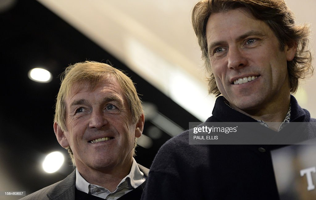 Former Liverpool football manager Kenny Dalglish (L) and comedian <a gi-track='captionPersonalityLinkClicked' href=/galleries/search?phrase=John+Bishop+-+Actor&family=editorial&specificpeople=7360807 ng-click='$event.stopPropagation()'>John Bishop</a> (R) pose at the launch of the Hillsborough charity recording 'He Ain't Heavy, He's My Brother' at HMV in Liverpool, north-west England on December 17, 2012. The recording has been made to support the families of Liverpool football club supporters who died during the Hillsborough Disaster in 1989. Proceeds will go towards legal costs in the families' continued fight to quash the accidental death inquest verdicts. An application to overturn the verdict was made by Attorney General Dominic Grieve and is due before the High Court in London on December 19.