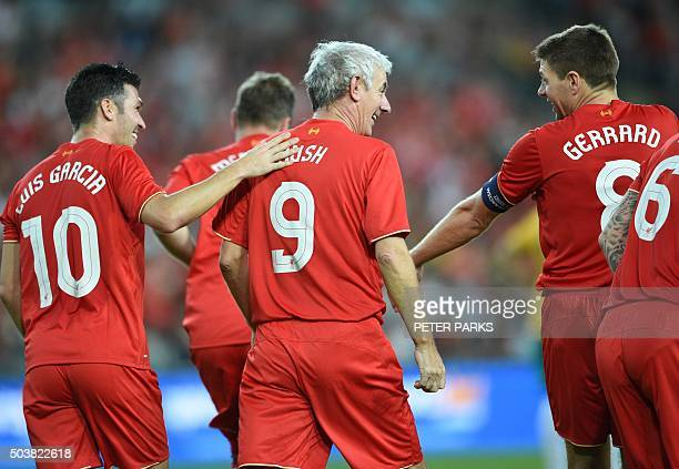 Former Liverpool football stars Ian Rush Luis Garcia and Steven Gerrard playing for Liverpool Legends celebrate a goal against Australian Legends in...