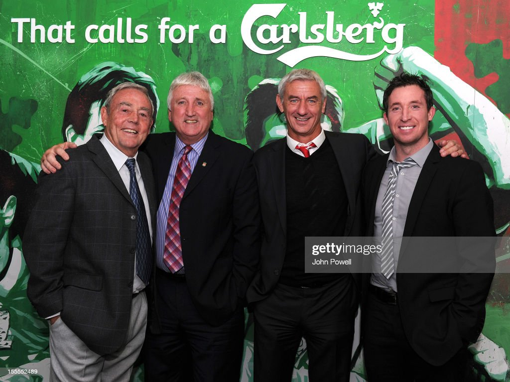 Former Liverpool number 9's (L-R) Ian St John, David Johnson, Ian Rush and Robbie Fowler pose prior to the Barclays Premier League match between Liverpool and Newcastle United at Anfield on November 4, 2012 in Liverpool, England.