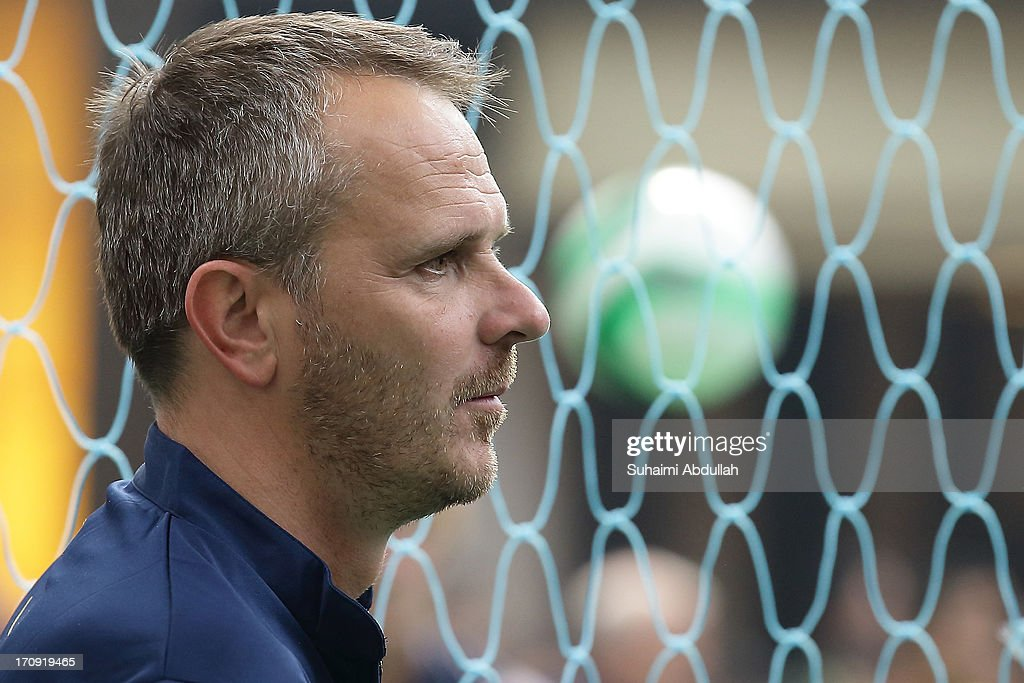 Former Liverpool player <a gi-track='captionPersonalityLinkClicked' href=/galleries/search?phrase=Dietmar+Hamann&family=editorial&specificpeople=204639 ng-click='$event.stopPropagation()'>Dietmar Hamann</a> takes part in a football clinic with students from designated charities and local Singapore schools during the Sands for Singapore event at the Skating Rink at The Shoppes Marina Bay Sands on June 20, 2013 in Singapore.