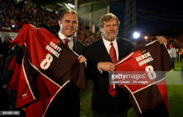 Former Llanelli captain Derek Quinnell and son and former captian Scott Quinnell pose with shirts with their names on the back before the EDF Energy...