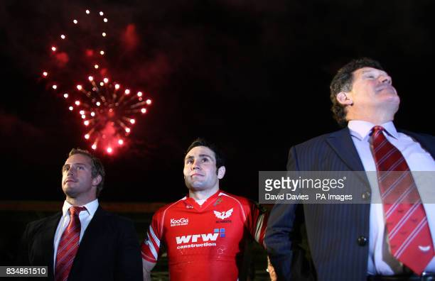 Former Llanelli player and coach Gareth Jenkins joins current player Stephen Jones to watch the fireworks after the final whistle during the EDF...