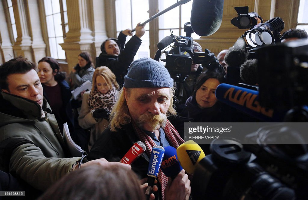 Former logistics operator of French charity Arche De Zoe (Zoe's Ark) Alain Peligat speaks to journalists as he arrives at the Paris courthouse on February 12, 2013, for the deliberation in the trial of members of former French charity organisation Arche de Zoe (Zoe's Ark), accused of illegal involvement in adoption procedures. The court sentenced two French aid workers to two years in jail for attempting to illegally bring 103 children from Chad to France for adoption, falsely claiming they were orphans from Darfur. Eric Breteau, who founded the Zoe's Ark charity that was involved in the failed attempt, and his partner Emilie Lelouch, were tried in absentia after refusing to show up for the proceedings.