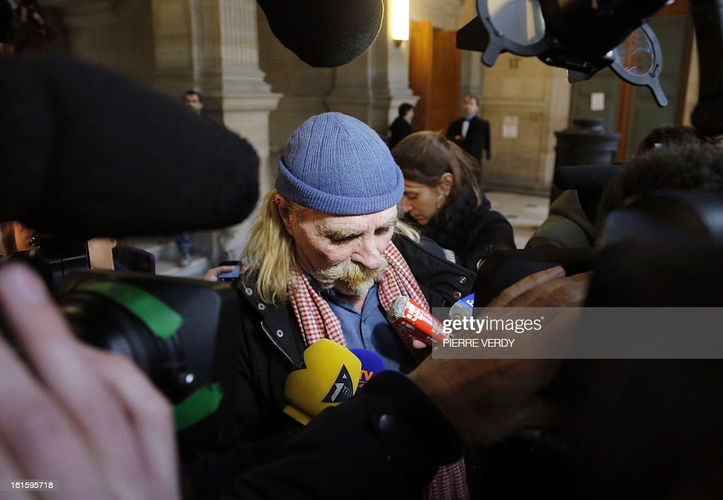 Former logistics operator of French charity Arche De Zoe (Zoe's Ark) Alain Peligat speaks to journalists at the Paris courthouse on February 12, 2013, after the deliberation in the trial of members of former French charity organisation Arche de Zoe (Zoe's Ark), accused of illegal involvement in adoption procedures. The court sentenced two French aid workers to two years in jail for attempting to illegally bring 103 children from Chad to France for adoption, falsely claiming they were orphans from Darfur. Eric Breteau, who founded the Zoe's Ark charity that was involved in the failed attempt, and his partner Emilie Lelouch, were tried in absentia after refusing to show up for the proceedings.