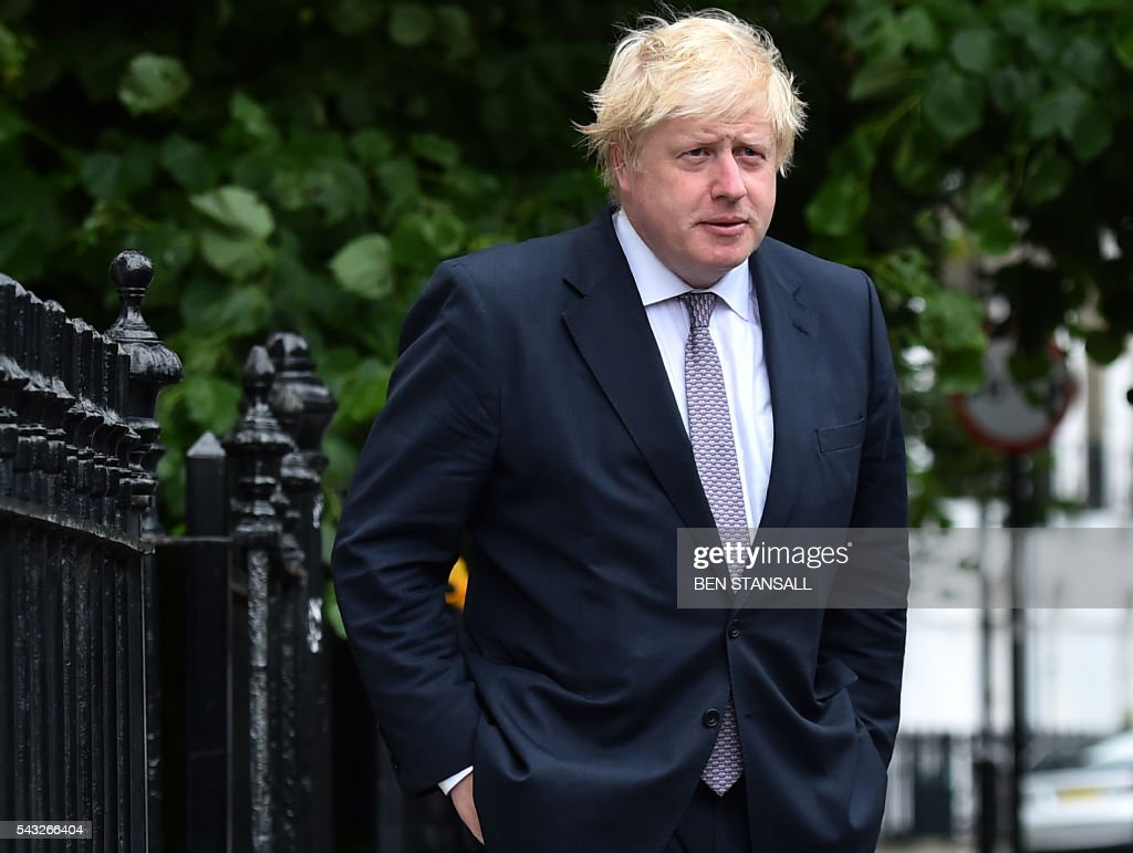 Former London mayor and Brexit campaigner Boris Johnson leaves his home in London on June 27, 2016. Shares in banks, airlines and property companies plunged on the London stock exchange Monday as investors singled out the three sectors as being the most vulnerable to Britain's decision to leave the EU. / AFP / BEN