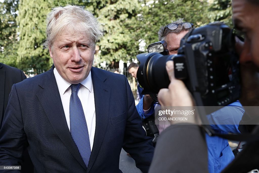Former London mayor and Brexit campaigner Boris Johnson (L) leaves his home in London on June 28, 2016. EU leaders attempted to rescue the European project and Prime Minister David Cameron sought to calm fears over Britain's vote to leave the bloc as ratings agencies downgraded the country. Britain has been pitched into uncertainty by the June 23 referendum result, with Cameron announcing his resignation, the economy facing a string of shocks and Scotland making a fresh threat to break away. / AFP / ODD