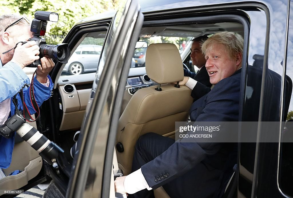 Former London mayor and Brexit campaigner Boris Johnson (R) leaves his home in London on June 28, 2016. EU leaders attempted to rescue the European project and Prime Minister David Cameron sought to calm fears over Britain's vote to leave the bloc as ratings agencies downgraded the country. Britain has been pitched into uncertainty by the June 23 referendum result, with Cameron announcing his resignation, the economy facing a string of shocks and Scotland making a fresh threat to break away. / AFP / ODD