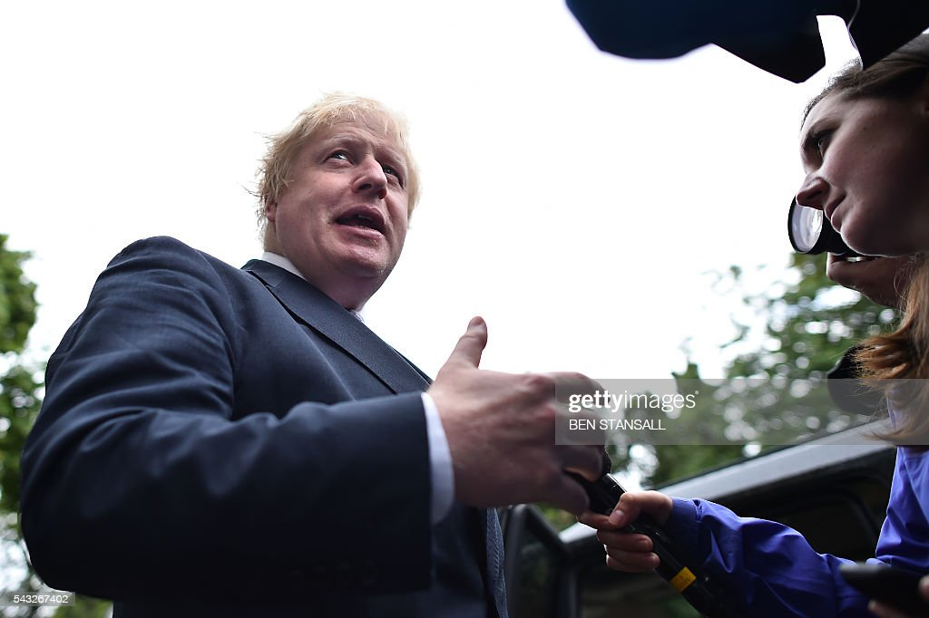 Former London mayor and Brexit campaigner Boris Johnson speaks to the press as he leaves his home in London on June 27, 2016. Shares in banks, airlines and property companies plunged on the London stock exchange Monday as investors singled out the three sectors as being the most vulnerable to Britain's decision to leave the EU. / AFP / BEN