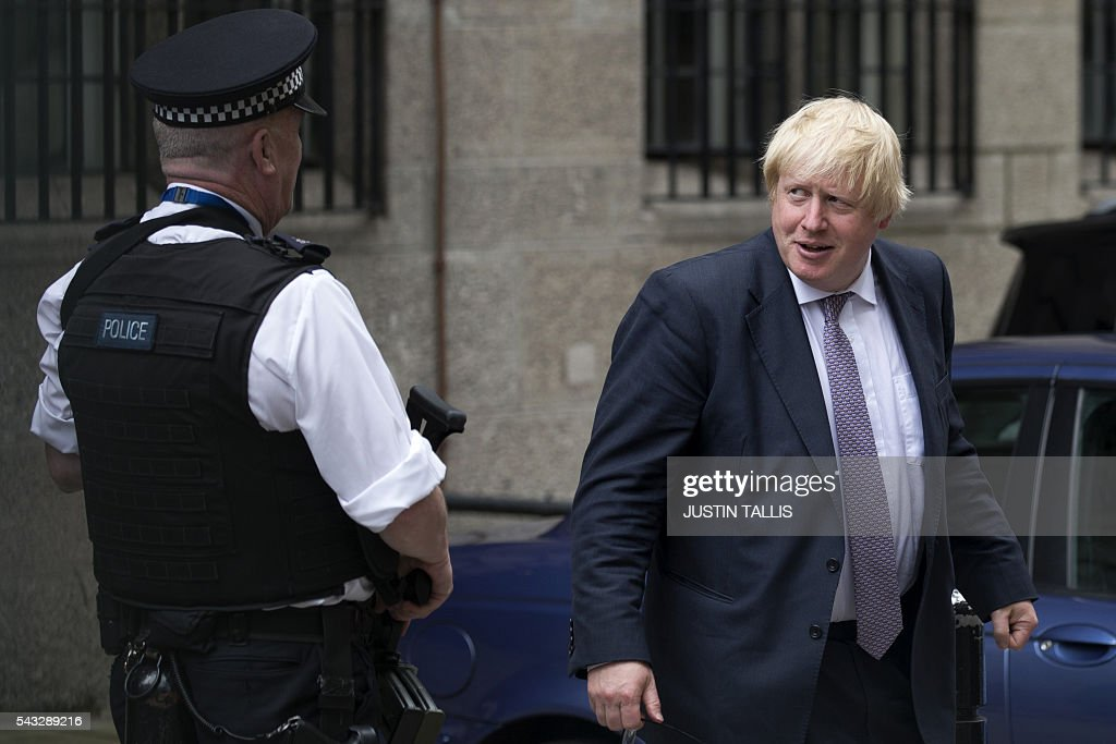 Former London mayor and Brexit campaigner Boris Johnson walks through buildings inside the Houses of Parliament and Portcullis House in central London on June 27, 2016. Britain should only trigger Article 50 to leave the EU when it has a 'clear view' of how its future in the bloc looks, finance minister George Osborne said Monday following last week's shock referendum. London stocks sank more than 0.8 percent in opening deals on Monday, despite attempts by finance minister George Osborne to calm jitters after last week's shock Brexit vote. / AFP / JUSTIN