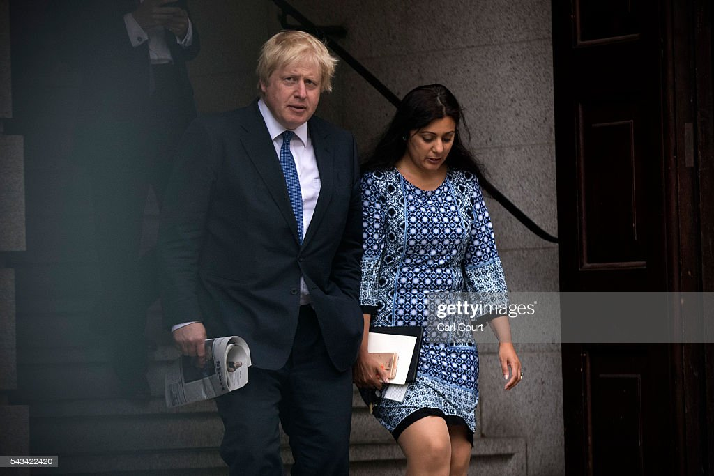Former London Mayor <a gi-track='captionPersonalityLinkClicked' href=/galleries/search?phrase=Boris+Johnson&family=editorial&specificpeople=209016 ng-click='$event.stopPropagation()'>Boris Johnson</a> (L) walks through Portcullis House on June 28, 2016 in London, England. Mr Johnson is thought to be the frontrunner to succeed Prime Minister David Cameron who resigned following the European Union referendum result to leave.