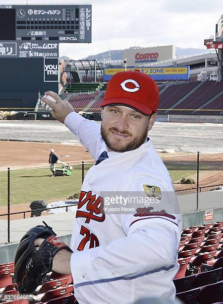 Former Los Angeles Angels relief pitcher Ryan Brasie poses for a photo at Mazda Stadium in Hiroshima on Jan 25 after he was introduced by the...