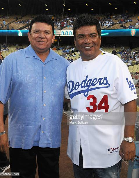 Former Los Angeles Dodger player Fernando Valenzuela and actor George Lopez on the field during Fernando Valenzuela Bobblehead Night at Dodger...