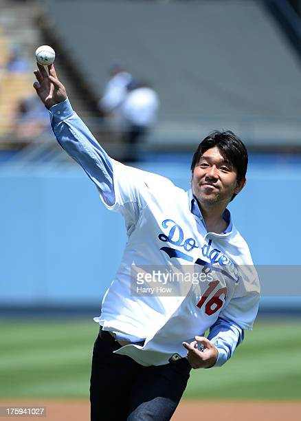 Former Los Angeles Dodgers Hideo Nomo of Japan pitches a ceremonial first pitch before the game against the Tampa Bay Rays at Dodger Stadium on...
