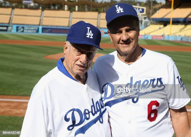 Former Los Angeles Dodgers managers Tommy Lasorda and Joe Torre pose for a picture during batting practice for the Dodgers Old Timer's game at Dodger...