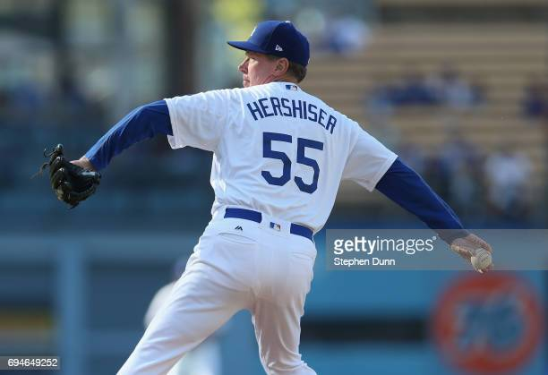 Former Los Angeles Dodgers pitcher Orel Hershiser throws a pitch during the Dodgers Old Timer's game at Dodger Stadium on June 10 2017 in Los Angeles...