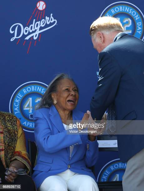 Former Los Angeles Dodgers play by play announcer Vin Sculley shakes the hand of Rachel Robinson onstage during the Los Angeles Dodgers Jackie...