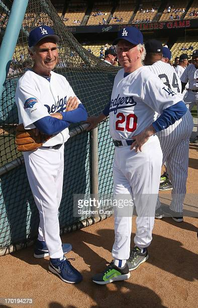 Former Los Angeles Dodgers Sandy Koufax and Don Sutton talk as they gather with former the New York Yankees for an Old Timers game before the game...