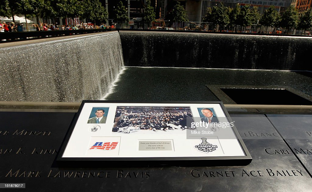 Former Los Angeles Kings Player Luc Robitaille and Los Angeles Kings Governor Tim Leiweke lay a plague at the reflexting pool above the engraved names of Garnet 'Ace' Bailey, the Kings' director of pro scouting, and amateur scout Mark Bavis in lower Manhattan at the World Trade Center site on September 12, 2012 in New York City.The Los Angeles Kings felt the loss of Garnet 'Ace' Bailey, the Kings' director of pro scouting, and amateur scout Mark Bavis when hijackers took control of their scheduled Boston-to-Los Angeles flight and crashed the plane into the south tower of New York's World Trade Center.