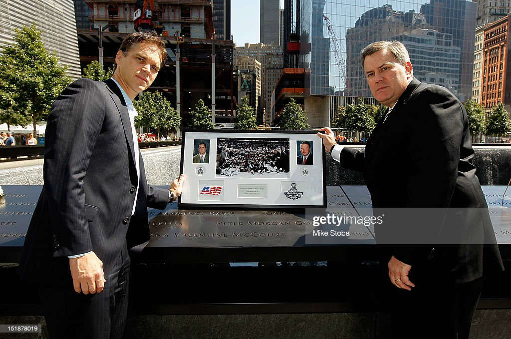 Former Los Angeles Kings Player Luc Robitaille and Los Angeles Kings Governor <a gi-track='captionPersonalityLinkClicked' href=/galleries/search?phrase=Tim+Leiweke&family=editorial&specificpeople=676996 ng-click='$event.stopPropagation()'>Tim Leiweke</a> lay a plague at the reflexting pool above the engraved names of Garnet 'Ace' Bailey, the Kings' director of pro scouting, and amateur scout Mark Bavis in lower Manhattan at the World Trade Center site on September 12, 2012 in New York City.The Los Angeles Kings felt the loss of Garnet 'Ace' Bailey, the Kings' director of pro scouting, and amateur scout Mark Bavis when hijackers took control of their scheduled Boston-to-Los Angeles flight and crashed the plane into the south tower of New York's World Trade Center.