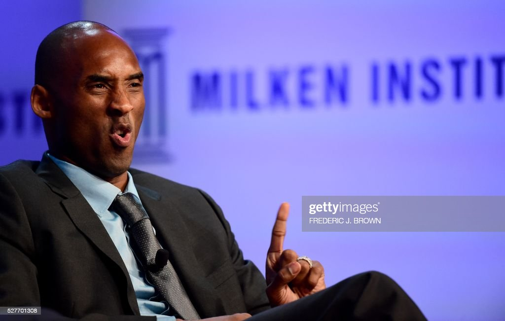 Former Los Angeles Laker Kobe Bryant gestures while responding to questions from sportscaster Jim Gray during the 'End of an Era: A Conversation with NBA Great Kobe Bryant' discussion at the 2016 Milken Institute Global Conference in Beverly Hills, California on May 3, 2016. / AFP / FREDERIC