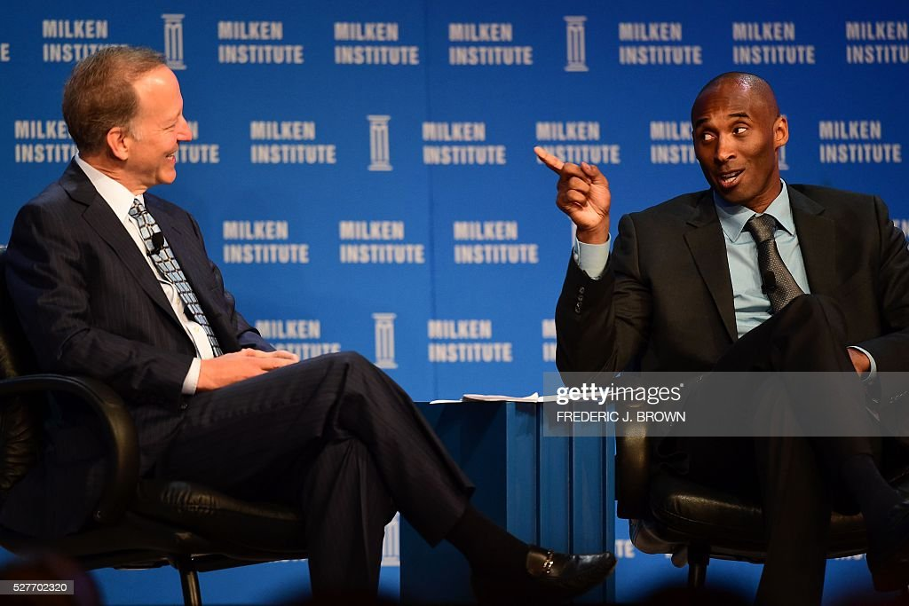 Former Los Angeles Laker Kobe Bryant(R) responds to questions from sportscaster Jim Gray during the 'End of an Era: A Conversation with NBA Great Kobe Bryant' discussion at the 2016 Milken Institute Global Conference in Beverly Hills, California on May 3, 2016. / AFP / FREDERIC