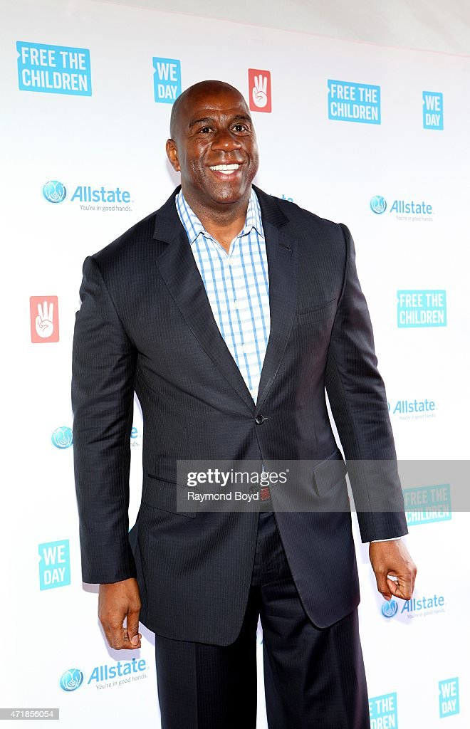 Former Los Angeles Lakers basketball player entrepreneur and philanthropist Ervin 'Magic' Johnson poses for photos on the red carpet during 'We Day'...