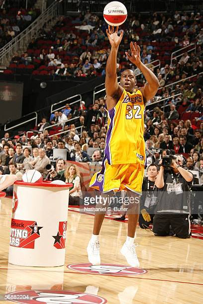 Former Los Angeles Lakers guard Earvin 'Magic' Johnson shoots during the Radio Schack Shooting Stars competition on AllStar Saturday Night during...