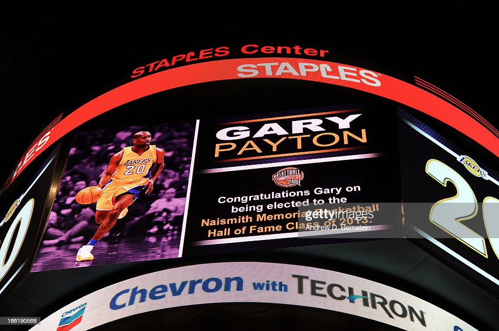 Former Los Angeles Lakers player Gary Payton is recognized for being selected for induction into the Naismith Memorial Hall of Fame during a game between the New Orleans Hornets and Lakers at Staples Center on April 9, 2013 in Los Angeles, California.