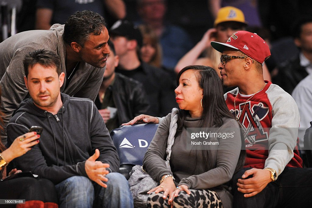 Former Los Angeles Lakers player Rick Fox, left, greets recording artist T.I. and his wife Temeka Cottle during a game between the Utah Jazz and Lakers at Staples Center on January 25, 2013 in Los Angeles, California.