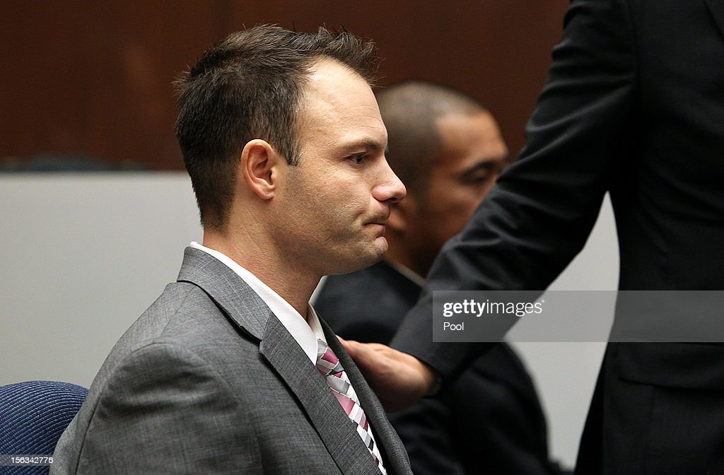 Former Los Angeles police officer Evan Samuel reacts after the jury found him guilty of perjury and conspiracy to obstruct justice at the Criminal Justice Center on November 13, 2012 in Los Angeles, California. The two officers were convicted after lying under oath in a 2008 drug possession case.
