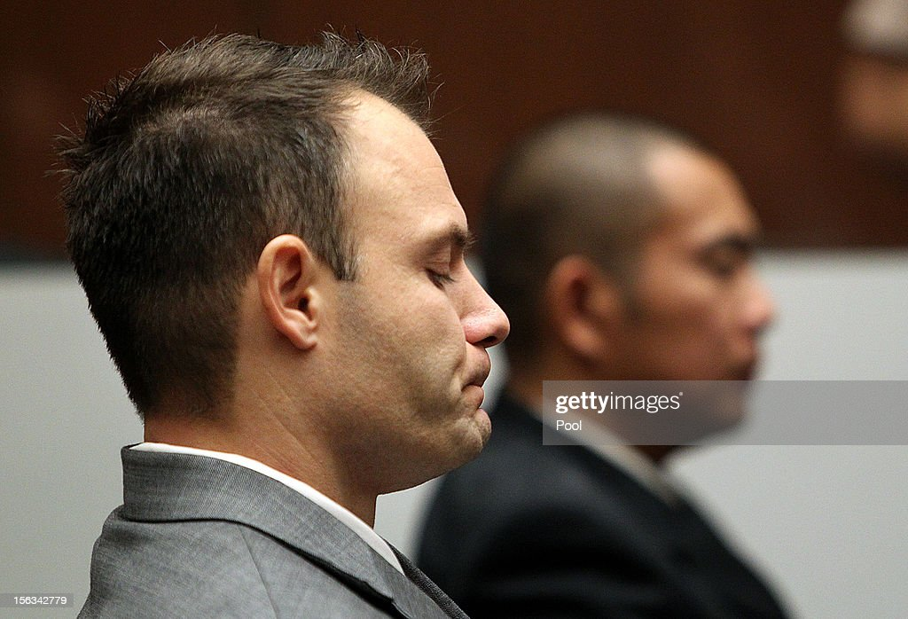 Former Los Angeles police officer Evan Samuel (L), reacts after the jury found both him and officer Richard Amio (R), guilty of perjury and conspiracy to obstruct justice at the Criminal Justice Center on November 13, 2012 in Los Angeles, California. The two officers were convicted after lying under oath in a 2008 drug possession case.