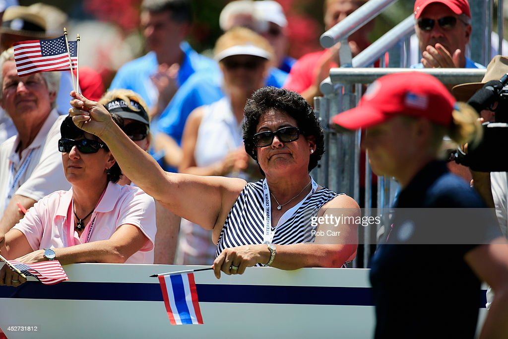 Former LPGA golfer <a gi-track='captionPersonalityLinkClicked' href=/galleries/search?phrase=Nancy+Lopez&family=editorial&specificpeople=221375 ng-click='$event.stopPropagation()'>Nancy Lopez</a> waves an American flag as <a gi-track='captionPersonalityLinkClicked' href=/galleries/search?phrase=Stacy+Lewis+-+Golfer&family=editorial&specificpeople=4217318 ng-click='$event.stopPropagation()'>Stacy Lewis</a> (R) of the United States waits to tee off during round three of the International Crown at Caves Valley Golf Club on July 26, 2014 in Owings Mills, Maryland.