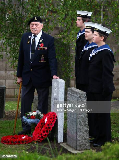 Former machine gunner Alf Tubb left unveils a headstone at Comely Bank Cemetery in Edinburgh in memory of Reginald Earnshaw his friend and former...