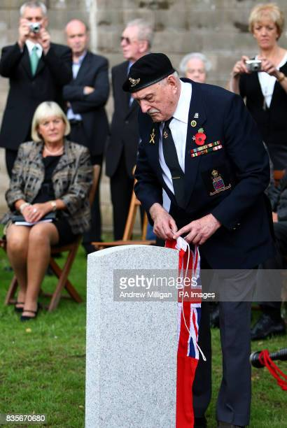 Former machine gunner Alf Tubb unveils a headstone at Comely Bank Cemetery in Edinburgh in memory of Reginald Earnshaw his friend and former shipmate...