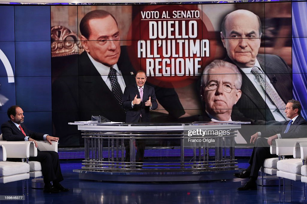 Former magistrate anti-mafia and candidate for premier, judge Antonio Ingroia, TV conductor Bruno Vespa and President of the Italian Chamber of Deputies and leader of the center-right Future and Freedom party, Gianfranco Fini attend 'Porta a Porta' Italian TV Show, while portraits of Silvio Berlusconi, Mario Monti and Pierluigi Bersani are displayed in the background on January 21, 2013 in Rome, Italy.