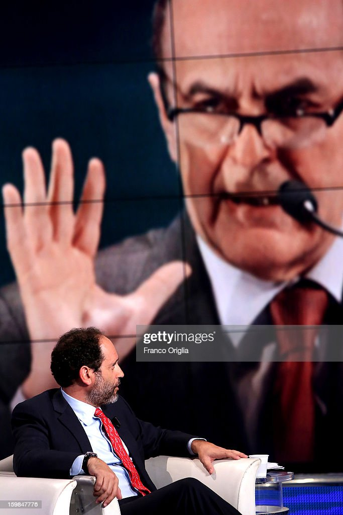 Former magistrate anti-mafia and candidate for premier judge Antonio Ingroia attends 'Porta a Porta' Italian TV Show while a portrait of Democratic Party (PD) secretary Pier Luigi Bersani is displayed in the background on January 21, 2013 in Rome, Italy.