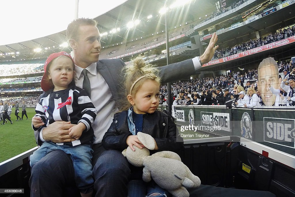 Former Magpies captain Nick Maxwell, who recently retired, does a lap on honour with his children before the round 19 AFL match between the Collingwood Magpies and the Port Adelaide Power at Melbourne Cricket Ground on August 3, 2014 in Melbourne, Australia.
