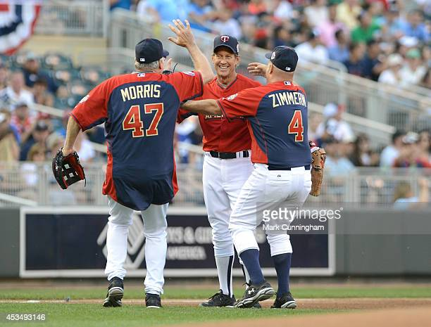 Former Major League Baseball pitcher Jack Morris television actor James Denton and television personality Andrew Zimmern celebrate after Denton made...