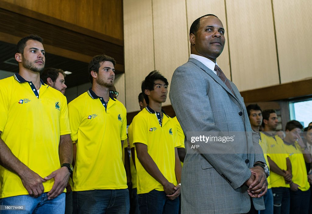US former Major League Baseball player and now Brazlian National Baseball team coach Barry Larkin (R), poses with his team players during a reception at the Japanese consulate for their first participation in the World Baseball Classic (WBC), in Sao Paulo, Brazil, on Februrary 5, 2013. WBC first round will start from March 2 in Japan, Taiwan, Puerto Rico and the US with 16 teams from around the world taking part. AFP PHOTO/Yasuyoshi CHIBA