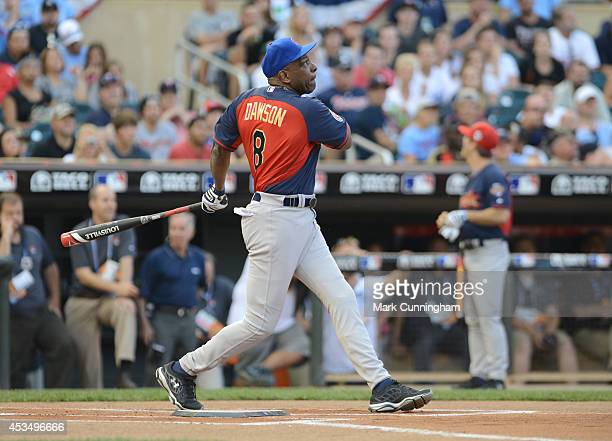 Former Major League Baseball player Andre Dawson bats during the 2014 Taco Bell MLB AllStar Legends Celebrity Softball Game at Target Field on July...