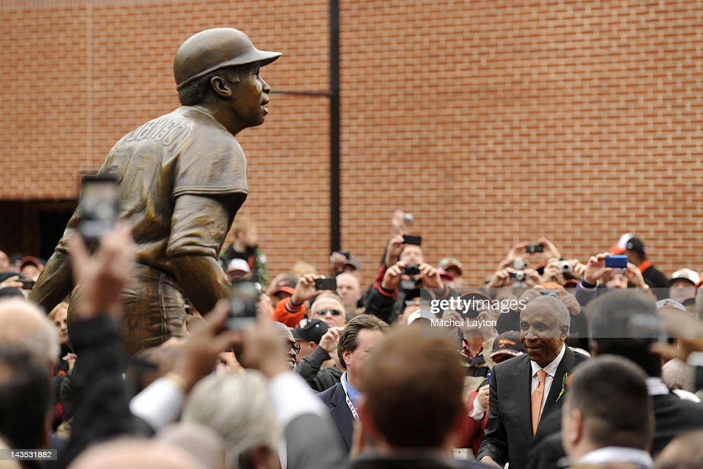 Former major league baseball player <a gi-track='captionPersonalityLinkClicked' href=/galleries/search?phrase=Frank+Robinson&family=editorial&specificpeople=167022 ng-click='$event.stopPropagation()'>Frank Robinson</a> watches the unveiling of his bronze sculpture before a baseball game between the Baltimore Orioles and Oakland Athletics at Oriole Park at Camden Yards on April 28, 2012 in Baltimore, Maryland.