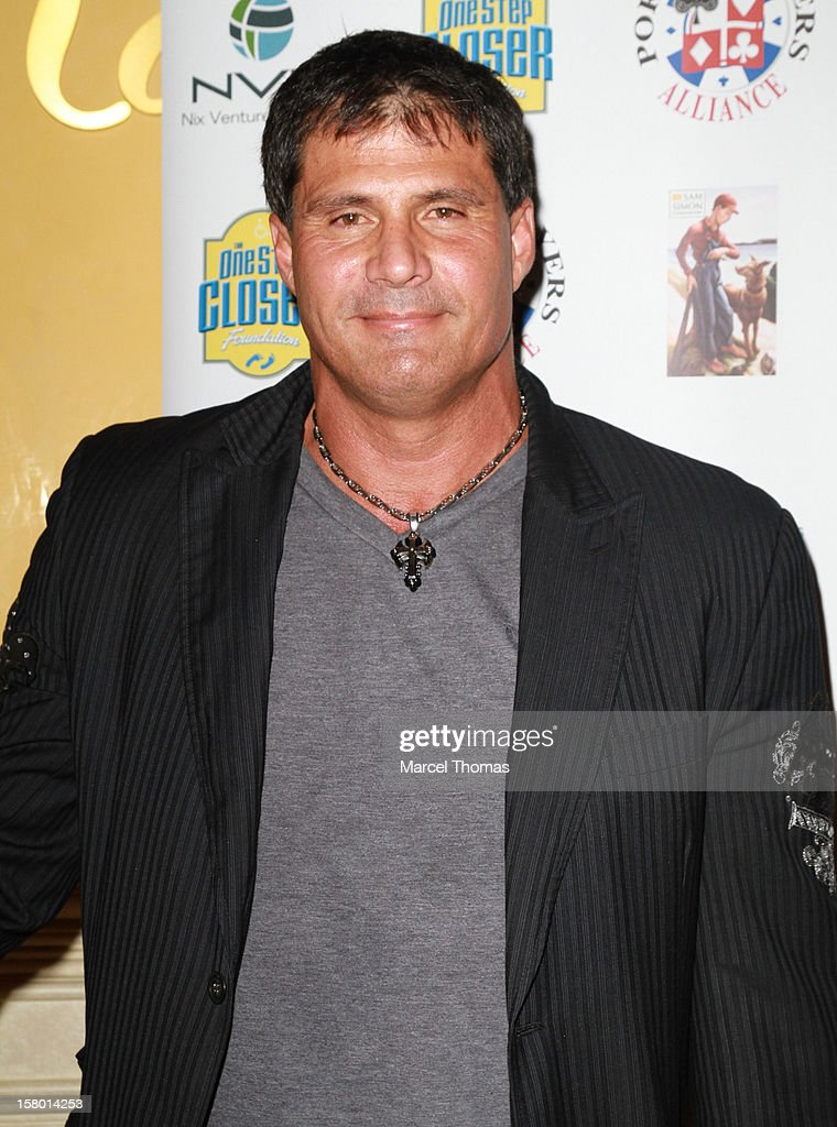 Former Major league baseball player <a gi-track='captionPersonalityLinkClicked' href=/galleries/search?phrase=Jose+Canseco&family=editorial&specificpeople=203063 ng-click='$event.stopPropagation()'>Jose Canseco</a> attends the 5th Annual 'All in for CP' Celebrity Poker tournament at the Venetian Hotel and Casino Resort on December 8, 2012 in Las Vegas, Nevada.