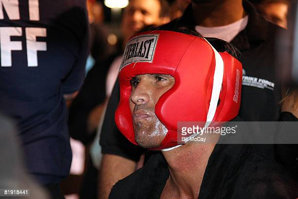Former Major League Baseball player Jose Canseco sits in the ring before his bout with former NFL player Via Sikahema during their celebrity boxing...