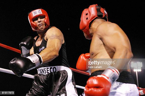 Former Major League Baseball player Jose Canseco swings a left at former NFL player Via Sikahema during their celebrity boxing match on July 12 2008...