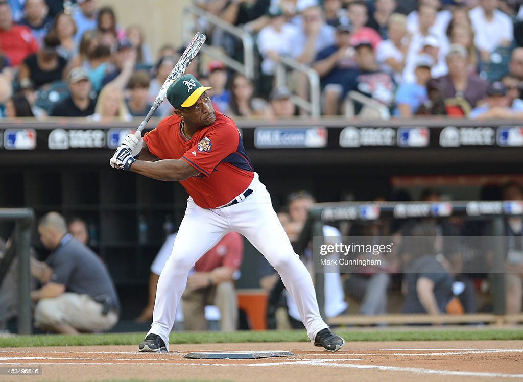 Former Major League Baseball player Rickey Henderson bats during the 2014 Taco Bell MLB All-Star Legends & Celebrity Softball Game at Target Field on July 13, 2014 in Minneapolis, Minnesota.